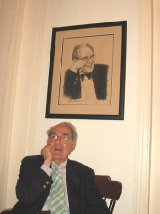 Photograph of NYT art critic Hilton Kramer sitting under his drawing by Claude Buckley